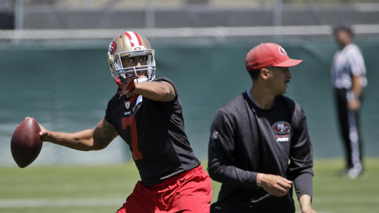 San Francisco 49ers quarterback Colin Kaepernick throws during an NFL football organized team activity, Tuesday, June 3, 2014, in Santa Clara, Calif. (AP Photo/Marcio Jose Sanchez)