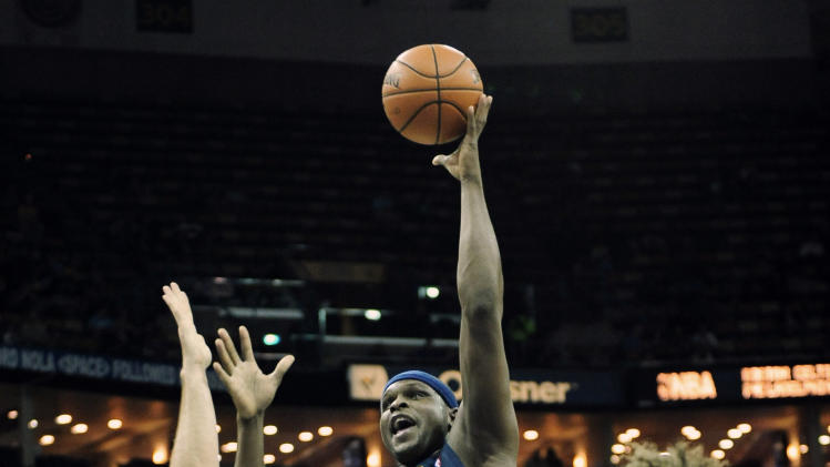 Memphis Grizzlies  forward Zach Rudolph (50) shoots over New Orleans Hornets center Ryan Anderson (33) and Robin Lopez (15) during the first half of an NBA basketball game in New Orleans, Friday Dec 7, 2012. (AP Photo/Stacy Revere)