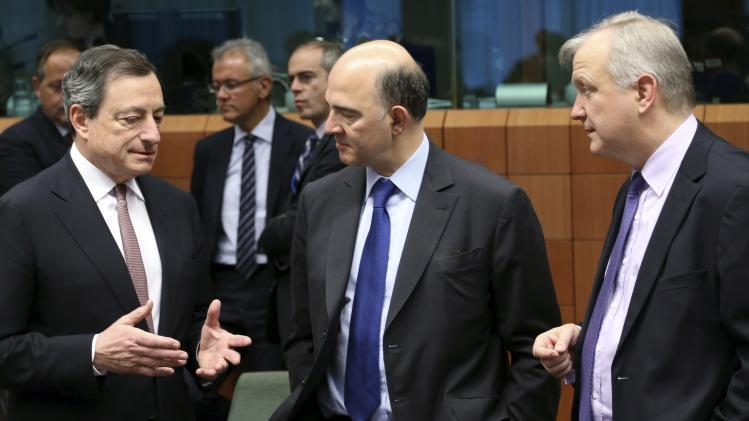 Draghi, Moscovici and Rehn attend an eurozone finance ministers meeting in Brussels