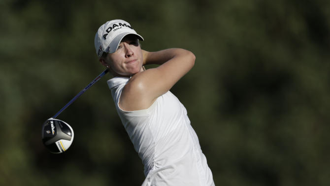 Jodi Ewart Shadoff, of England, watches her tee shot on the 16th hole during the first round of the LPGA Kraft Nabisco Championship golf tournament in Rancho Mirage, Calif. Thursday, April 4, 2013. (AP Photo/Chris Carlson)