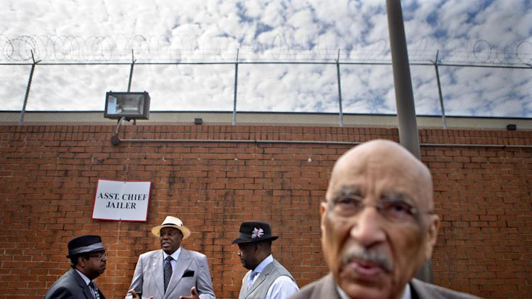 Rev. Timothy McDonald, from left, Rev. Gerald Durley, Rev. Darrell Elligan, and Jerome Harris, gather outside Fulton County Jail to protest the high bonds set for 35 defendants in Atlanta's school cheating scandal, Tuesday, April 2, 2013, in Atlanta. The 35 defendants are named in a 65-count indictment that alleges a broad conspiracy involving cheating on standardized tests in Atlanta Public Schools. All 35 defendants must turn themselves in Tuesday. (AP Photo/David Goldman)