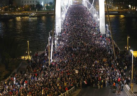 Thousands of Hungarians march across the Elisabeth Bridge during a protest against new tax on Internet data transfers in centre of Budapest