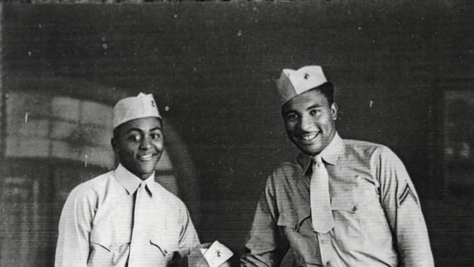 In this undated handout image provided by Carrel Reavis, Reavis is seen, right, posing with two other Marines in uniform. Nearly 70 years after the Marine Corps, the last military branch to racially integrate, accepted segregated black units, the Marine Corps' top general is pushing to honor the history of the Monfort Point Marines. (AP Photo)