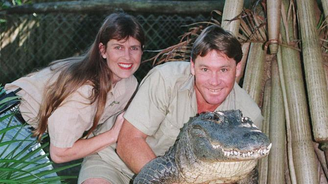 """FILE - In this June 18, 1999 file photo, Steve Irwin, """"The Crocodile Hunter"""" holds a nine-foot female alligator accompanied by his American wife Terri, who is from Eugene, Oregon, at his """"Australia Zoo"""" in Beerwah, Queensland, Australia. Australia's famed """"Crocodile Hunter"""" Steve Irwin knew he was dying after a massive stingray stabbed him in the chest hundreds of times, the only witness to the fatal 2006 attack said in his first detailed public account of the beloved conservationist's death. (AP Photo/Russell McPhedran, File)"""