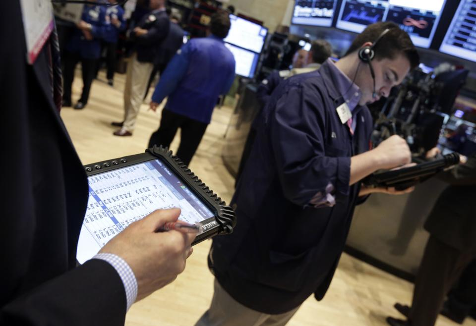 Traders on the floor of the New York Stock Exchange Friday, July 5, 2013. Robust hiring in the U.S. is boosting the stock market in early trading. (AP Photo/Richard Drew)