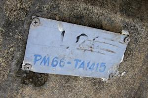 In this Nov. 27, 2014 photo, a metal plaque on a concrete…