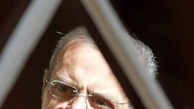 CORRECTS DATE PHOTO TAKEN - Jacques Gonzalez, an, accomplice of Thierry Tilly, leaves the court of Bordeaux, southwestern France, in this Thursday Sept. 27, 2012 photo. Gonzalez was sentenced to  four years in prison, Tuesday, Nov. 13, 2012. Tilly, an alleged modern-day Rasputin was convicted Tuesday of brainwashing three generations of an aristocratic French family for nearly a decade, swindling them of their fortune and their turreted manor and was sentenced to eight years in prison by the court. (AP Photo)