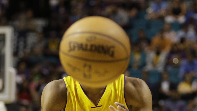 Los Angeles Lakers forward Wesley Johnson (11) passes the ball against the Sacramento Kings during an NBA preseason basketball game Friday, Oct. 24, 2014, in Las Vegas. (AP Photo/John Locher)