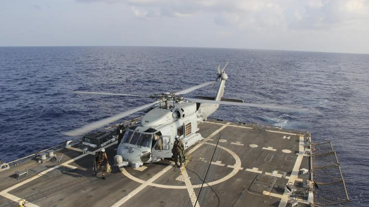 Handout picture of U.S. Navy SH-60R Seahawk helicopter lands on the destroyer USS Pinckney in the Gulf of Thailand, during operations in the search for missing Malaysian Airlines flight MH370