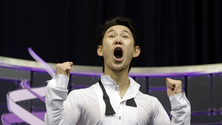 Denis Ten of Kazakhstan reacts to his scores during the men's free skate program at the World Figure Skating Championships Friday, March 15, 2013, in London, Ontario. (AP Photo/Darron Cummings)