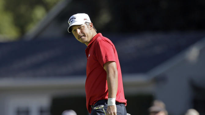 Fredrik Jacobson, of Sweden, watches the eagle putt miss and makes birdie on the first green in the final round of the Northern Trust Open golf tournament at Riviera Country Club in the Pacific Palisades area of Los Angeles, Sunday, Feb. 17, 2013. (AP Photo/Reed Saxon)