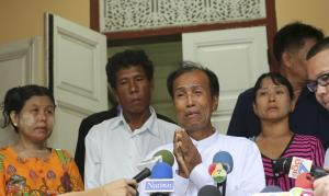 Tun tun Htike, center, father of arrested Myanmar migrant…