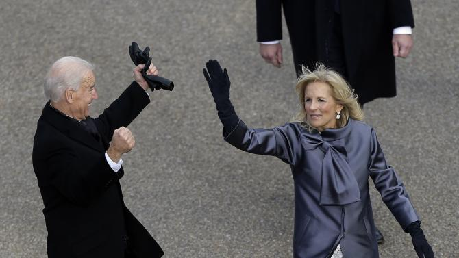 Vice President Joe Biden and his wife Jill Biden  walk down Pennsylvania Avenue en route to the White House, Monday, Jan. 21, 2013, in Washington. Thousands  marched during the 57th Presidential Inauguration parade after the ceremonial swearing-in of President Barack Obama. (AP Photo/Charlie Neibergall )
