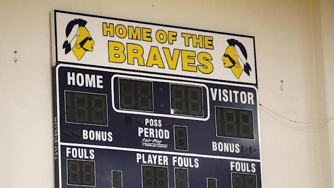 The Banks High School score board is shown on the wall of their gym Wednesday, May 16, 2012, in Banks, Ore. The Oregon Board of Education is scheduled to vote on a resolution that would require Oregon schools to retire their Native American mascots within five years or risk losing state funding. The vote Thursday could give Oregon some of the nation's toughest restrictions on American Indian nicknames, mascots and logos. If approved, eight high schools would need to change their nickname and mascot by July 2017 or lose state money. Seven schools identified as the Warriors would only have to alter their mascot. (AP Photo/Rick Bowmer)