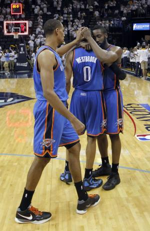 Oklahoma City Thunder guard Thabo Sefolosha, of Switzerland, left, guard Russell Westbrook (0) and James Harden, right, celebrate after beating the Memphis Grizzlies in Game 4 of a second-round NBA basketball playoff series on Tuesday, May 10, 2011, in Memphis, Tenn. Oklahoma City won 133-123 in triple overtime. (AP Photo/Lance Murphey)
