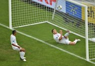 England defender John Terry clears the ball from the line during the Euro 2012 football championships match against Ukraine at the Donbass Arena in Donetsk, Ukraine, on June 19. UEFA&#39;s chief refereeing officer Pierluigi Collina on Wednesday said that the effort which was ruled out for not crossing the goal line should have been given