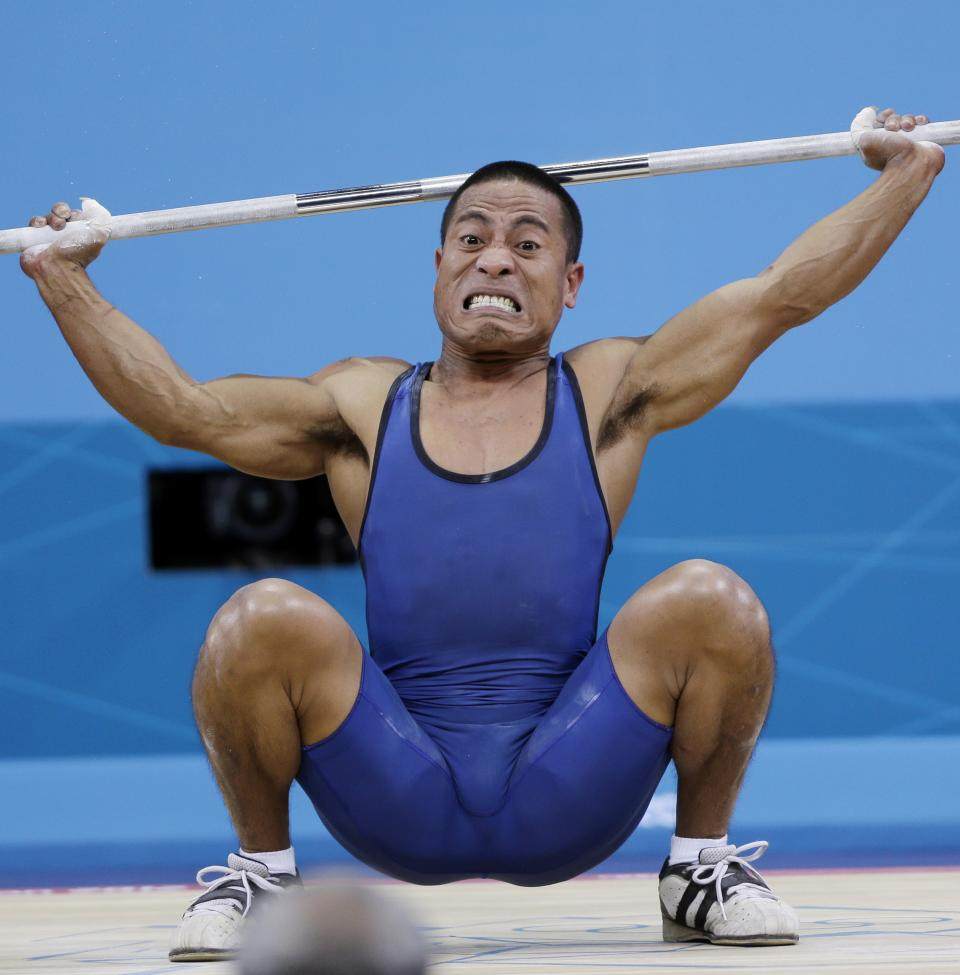 Manuel Minginfel off Micronesia competes during the mens 62-kg weightlifting competition at the 2012 Summer Olympics, Monday, July 30, 2012, in London. (AP Photo/Mike Groll)