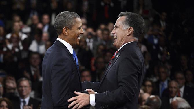FILE - In this Oct. 22, 2012 file photo, President Barack Obama, left, and Republican presidential nominee Mitt Romney laugh at the conclusion of the the third presidential debate at Lynn University in Boca Raton, Fla. Chinese have long been fascinated with U.S. presidential elections, but interest is particularly high this year because Americans are voting at the same time Beijing is going through its own political transition. (AP Photo/Pool-Michael Reynolds, File)