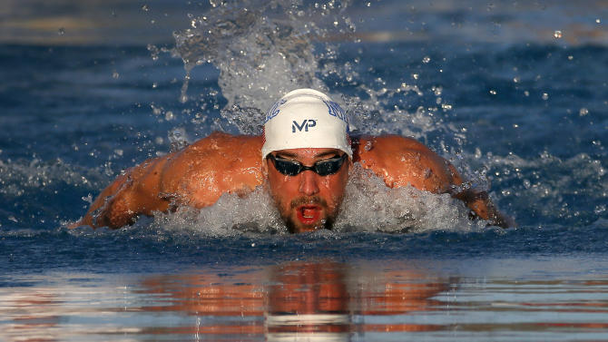 Michael Phelps competes in the men's 200-meter individual medley final, Saturday, April 18, 2015, at the Arena Pro Swim Series in Mesa, Ariz. Phelps finished in third place; Ryan Lochte won the race. (AP Photo/Matt York)