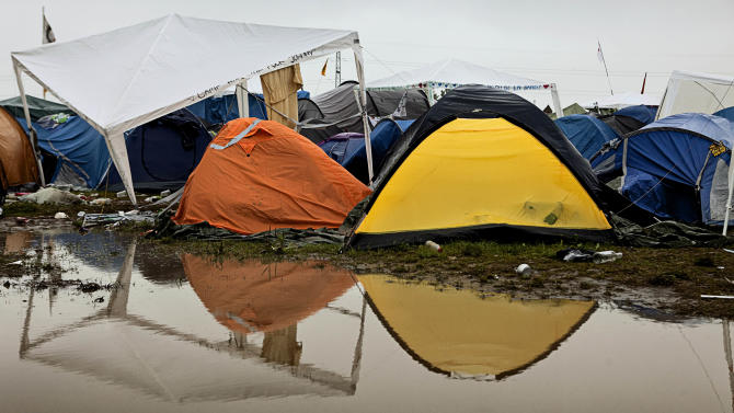 The calm after the storm, as tents are pitched on the high ground following heavy rain during the Roskilde Festival, early Saturday, July 2, 2011.  Some 75,000 ticket holders are expected to participate in the gigantic music festival which continues until Sunday, although rain storms are predicted. (AP Photo/POLFOTO, Jakob Joergensen)  DENMARK OUT