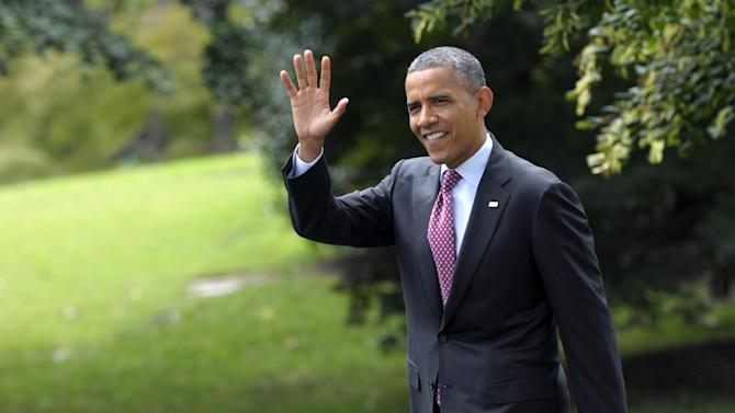 President Barack Obama waves as walks from the Oval Office to Marine One on the South Lawn of the White House in Washington, Wednesday, Sept. 5, 2012. Obama is heading to Charlotte, N.C., for the Democratic National Convention. (AP Photo/Susan Walsh)
