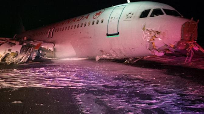 """A Sunday, March 29, 2015 photo provided by the Transportation Safety Board of Canada shows a Air Canada Airbus A-320 at Halifax International Airport after an """"abrupt"""" landing. The Airbus 320 skidded off the runway at the Halifax airport in bad weather, and officials said Sunday 23 people were taken to a hospital for observation and treatment of minor injuries. None of the injuries were considered life threatening, Air Canada said. (AP Photo/The Transportation Safety Board of Canada)"""