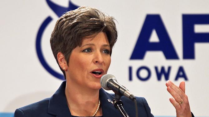 In this Oct. 23, 2013 photo is state Sen. Joni Ernst during a Senate debate in Des Moines, Iowa. In a Wednesday, March 5, 2014 press release from state Ernst, former Republican presidential nominee Mitt Romney backed the Iowa Republican in the crowded GOP primary for Iowa's open U.S. Senate seat. Ernst is among six Republicans running in the June 3 primary. (AP Photo/The Des Moines Register, Bill Neibergall)