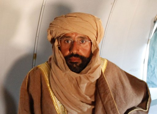 File photo of Saif al-Islam Gaddafi seen sitting in a plane in Zintan