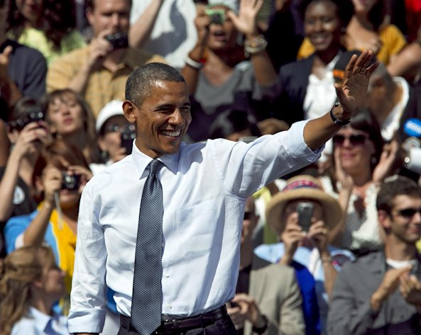 In this Sept. 13, 2012, photo, President Barack Obama waves after speaking at a campaign rally in Golden, Colo. Obama and Republican Mitt Romney are embarking on a week heavy with travel through battleground states and appeals key constituencies, with both campaigns wrangling over unrest in the Middle East and who is best equipped to rejuvenate the economy. Both candidates are courting voters in a series of must-win states and reaching out to a number of voting groups that could determine the election, from working-class white voters in states like Ohio and Wisconsin to Latino voters in Florida and viewers of a popular Spanish-language television network. (AP Photo/Ed Andrieski)