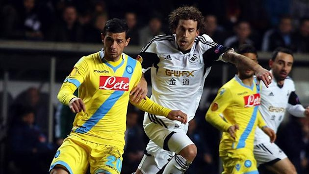 Napoli's Swiss midfielder Blerim Dzemaili (L) and Swansea City's Spanish midfielder Jose Alberto Canas (AFP)