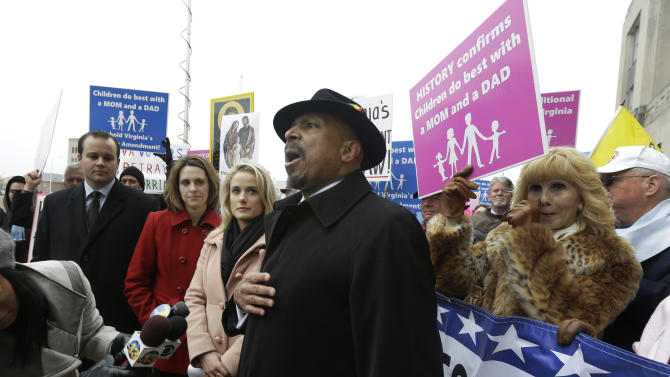 FILE - In a Tuesday, Feb. 4, 2014 file photo, former Republican candidate for lieutenant governor, E.W. Jackson, center, speaks to the media during a demonstration outside Federal Court in Norfolk, Va. Jackson spoke in favor of the law banning same sex marriage. In Virginia, Utah, Oklahoma and Kentucky, federal judges have struck down part or all of the bans on same-sex marriage that voters approved between 2004 and 2006. Each of the rulings has been stayed, pending appeals, but the trend is unsettling to the activists who oppose gay marriage. (AP Photo/Steve Helber, File)