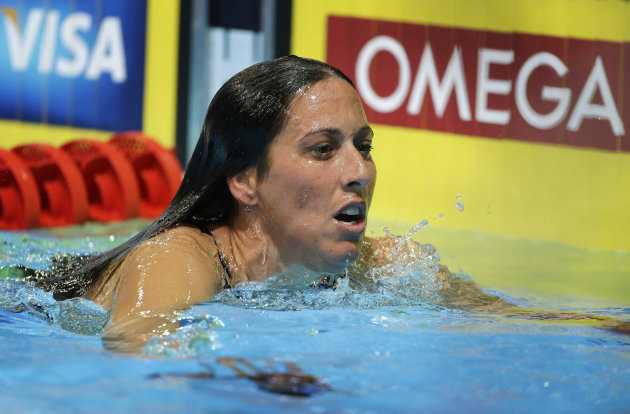 Janet Evans leaves her lane after swimming in the women's 800-meter freestyle preliminaries at the U.S. Olympic swimming trials on Saturday, June 30, 2012, in Omaha, Neb. (AP Photo/Mark Humphrey)