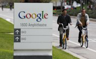 <p>               Google workers ride bikes outside of Google headquarters in Mountain View, Calif., Thursday, April 12, 2012. Google Inc. said Thursday that it earned $2.89 billion, or $8.75 per share, in the first quarter. That's up from $1.8 billion, or $5.51 per share, a year earlier. (AP Photo/Paul Sakuma)