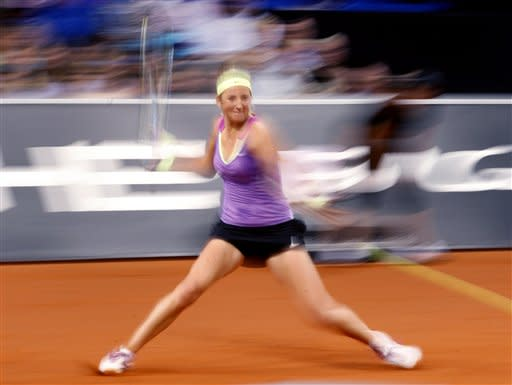 Belarus' Victoria Azarenka hits a forehand against Poland's Agnieszka Radwanska during their semifinal match at the Porsche Tennis Grand Prix in Stuttgart, Germany, Saturday, April 28, 2012. Azarenka won 6-1 and 6-3 to reach Sunday's final. (AP Photo/Michael Probst)