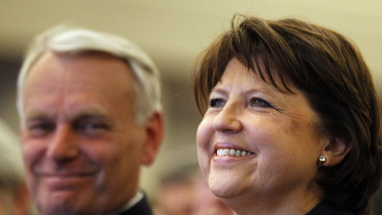 French Socialist secretary general Martine Aubry, right, and President of the Socialist group at the National Assembly Jean-Marc Ayrault attend the party's national council, in Paris, Monday, May 14, 2012. (AP Photo/Christophe Ena)