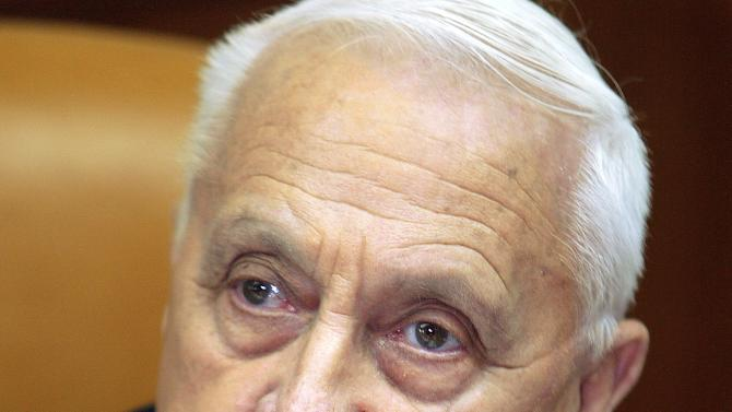 "FILE - In this Jan. 24, 2005 file photo, Israeli Prime Minister Ariel Sharon appears at the start of a meeting at his office, in Jerusalem. Seven years after a massive stroke removed him from office and left him in a vegetative state, comatose former Israeli Prime Minister Ariel Sharon is able to process information and has exhibited ""robust activity"" in his brain, one of the half-dozen doctors who recently tested him said Monday. (AP Photo/Brennan Linsley, File)"