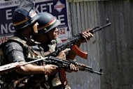 "Indian soldiers take position outside Nariman House, the scene of one of a string of coordinated attacks in Mumbai on November 27, 2008. India blames the Pakistan-based Lashkar-e-Taiba (LeT) militant organisation for training, equipping and financing the gunmen with support from ""elements"" in the Pakistan military"
