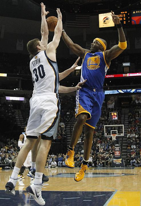 Golden State center Jermaine O'Neal (7) goes to the basket against Memphis Grizzlies forward Jon Leuer (30) in the first half of an NBA basketball game Saturday, Dec. 7, 2013, in Memphis, Tenn