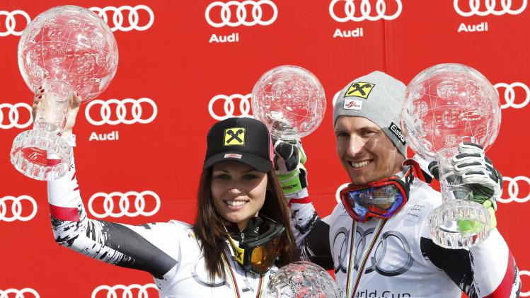 Women's giant slalom World Cup winner Fenninger of Austria and men's slalom World Cup winner Hirscher of Austria pose with their trophies during a ceremony after the FIS Alpine Skiing World Cup Finals in Lenzerheide