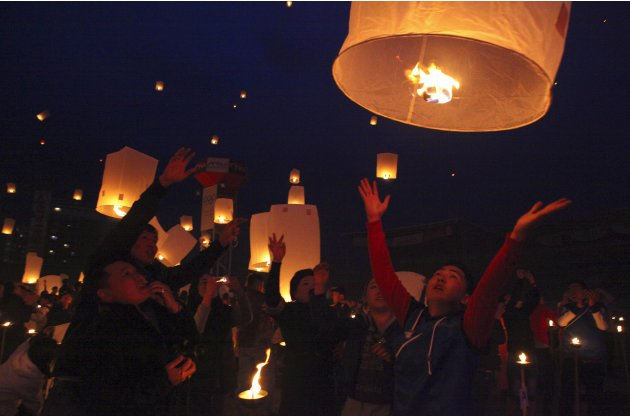 Buddhist believers release paper lanterns as they pay homage to Buddha on Visakha Puja day, also known as Vesak Day, at the Nadam stadium in Ulan Bator