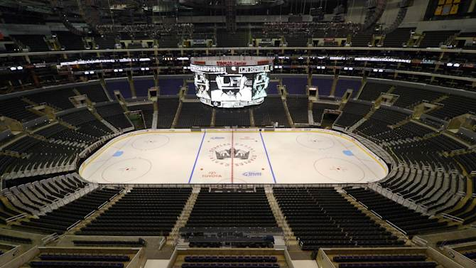 The Los Angeles Kings' ice rink is illuminated after a news conference to help kick off the club's 2012-13 regular season on Thursday, Jan. 10, 2013, in Los Angeles. (AP Photo/Mark J. Terrill)