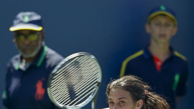 Marion Bartoli, of France, returns a shot to Kristina Mladenovic, of France, in the third round of play at the 2012 US Open tennis tournament,  Friday, Aug. 31, 2012, in New York. (AP Photo/Mel C. Evans)