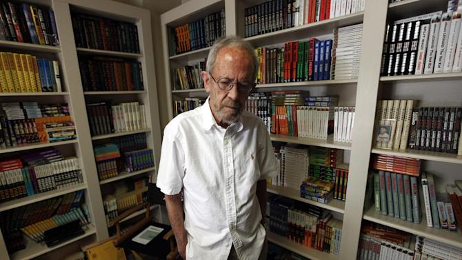 This Sept. 17, 2012 photo shows author Elmore Leonard, 86, stands at his Bloomfield Township, Mich., home. Leonard says he's thrilled to receive one of the literary world's highest honors, The National Book Foundation's Medal for Distinguished Contribution to American Letters. The crime novelist will be presented with the medal in New York on Nov. 14. (AP Photo/Paul Sancya)