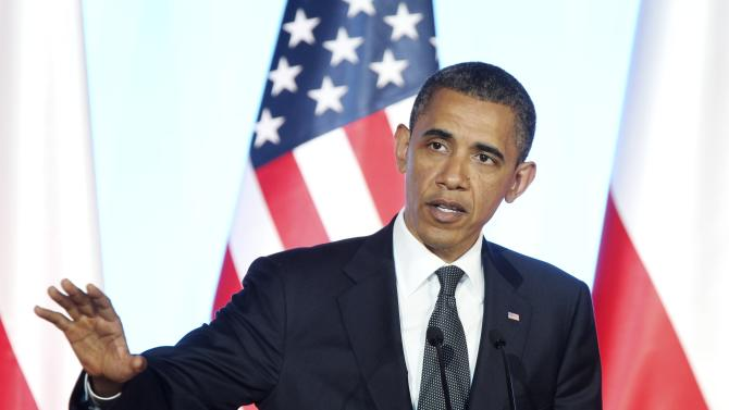The President of the United States Barack Obama speaks during a  press conference after meeting with Polish Prime Minister Donald Tusk in Warsaw, Saturday, May 28, 2011. (AP Photo/Michael Probst)