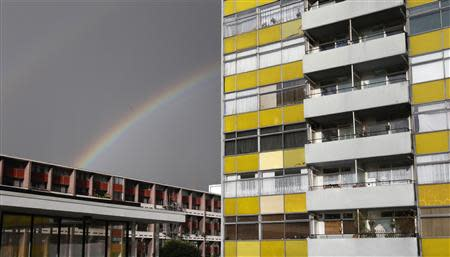 A rainbow appears over a housing estate in east London