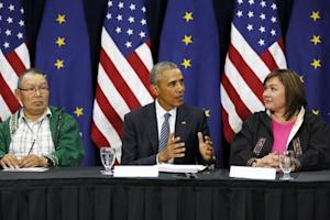 Obama is flanked by Naneng and Bahnke as he participates in a roundtable with Alaska natives before delivering remarks to the GLACIER Conference at the Dena'ina Civic and Convention Center in Anchorage, Alaska