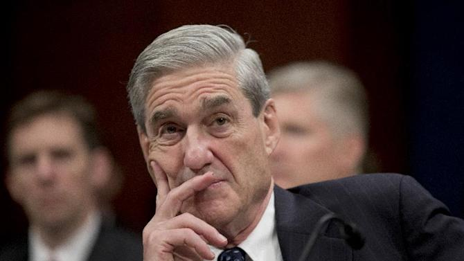 FBI Director Robert Mueller listens on Capitol Hill in Washington, Thursday, April 11, 2013, during the House Intelligence Committee hearing on worldwide threats. Mueller was among intelligence agency heads who testified before the committee.  (AP Photo/Manuel Balce Ceneta)