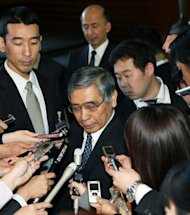 New Bank of Japan Governor Haruhiko Kuroda (C) is surrounded by reporters after his appointment by Prime Minister Shinzo Abe at the latter&#39;s office in Tokyo, on March 21, 2013. Kuroda, a finance veteran who backs aggressive easing measures to drag Japan out of its malaise, told Abe he would do his best to help right the world&#39;s third-largest economy