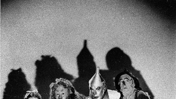 """FILE - In this undated file photo, Judy Garland, Bert Lahr, Jack Haley and Ray Bolger, left to right, are shown as they appeared in """"The Wizard of Oz,"""" the classic two-hour movie which helped lead to Judy Garland's fame. (AP Photo, File)"""