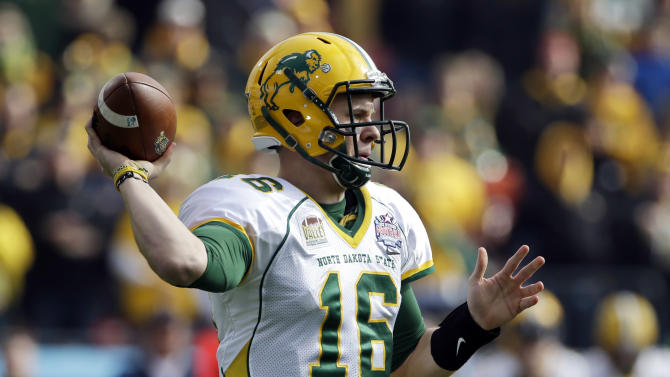 North Dakota State quarterback Brock Jensen throws a pass during the first half of the FCS Championship NCAA college football game against Sam Houston State, Saturday, Jan. 5, 2013, in Frisco, Texas. (AP Photo/Tony Gutierrez)